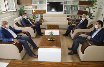 Başkan Güder'den Müdür Kanbay'a Hayırlı Olsun Ziyareti